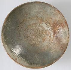 Bowl with Ornamented Rosette, Date: 11th–13th century Geography: Made in Possibly Corinth, Greece Culture: Byzantine Medium: Fired red earthenware, greenish/gray cream slip, clear glaze