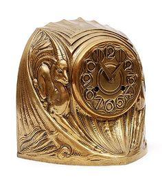 Found on www.botterweg.com - Bronze Amsterdam School pendulum with stylised decoration of chamois design attributed to Theo van Reijn 1884 - 1954 ca.1920