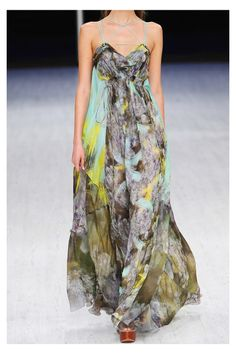 Matthew Williamson gown has brass-tipped turquoise shoulder ties that lace through brass eyelets and cross over at draped V-neck and back, folded pleats through front and back of skirt, pleated panels at empire line, and brass-tipped self ties at sides. Matthew Williamson's strikingly printed multicolored sheer silk-chiffon gown will ensure you stand out when the weather warms.