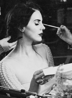 Lana Del Ray getting her makeup done