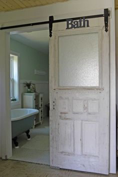 "Classic Wood Sliding Door in Farmhouse Bathroom Regular door used for the sliding door instead of a ""barn"" door. Don't like the crappy paint job though."