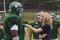 """""""The Blind Side"""" movie still, 2009. L to R: Quinton Aaron, Sandra Bullock. Bullock would win a Best Actress Academy Award for this movie. Michael Oher, American Football Movies, American Football Players, The Blind Side 2009, College Football Coaches, Fantasy League, Sports Mom, Sports Teams, Tim Mcgraw"""