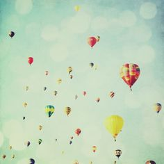Hot air balloons. This'd be cool painted on the walls of our guest/future kiddo's room. I like the colors and depth :)