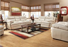 The Montoro Place sofa is the very essence of luxury. It boasts triple seating comfort upholstered in supple top grain leather in a decorator friendly taupe color. Extra plush pillowtop seats, thick padover arms and padded headrests in the back cushions offer sink-back support for full relaxation. Wood legs extend from the base.