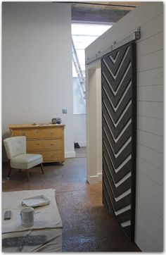 Heavy, industrial look closet door. Makes a bold statement. What do you think?