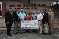 The Lackawanna County Commissioners awarded a $20,000 Community Re-Invest check to Spring Brook Township representatives for their community park program. The funding will be used to create a complex near the firehouse that features swing sets, a see-saw, play set, benches and ADA-compliant walkways.