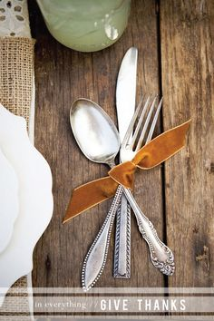 Mismatched silverware tied w a velvet ribbon