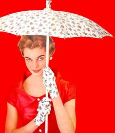 Betty always wears matching gloves with every umbrella.