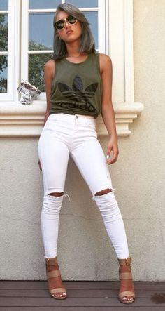 Love this! White ripped jeans and adidas olive green top with heels,