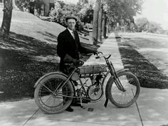 Arthur Davidson, co-founder of Harley-Davidson Motorcycles, with one of his early bikes.