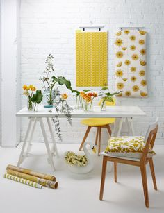White, yellow and wood. Fresh, clean and simple interiors with great colour