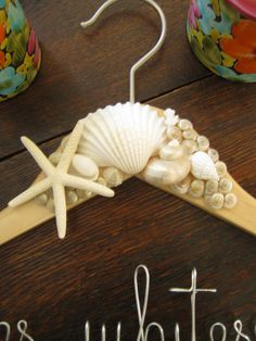 Beach Wedding Hanger - Starfish, Seashells and Coral Accents, Beach Bride Wedding, Nautical Wedding Dress hanger. $35.00, via Etsy.