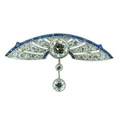 A gorgeous, Art Deco, platinum, diamond, and sapphire brooch. 1920s