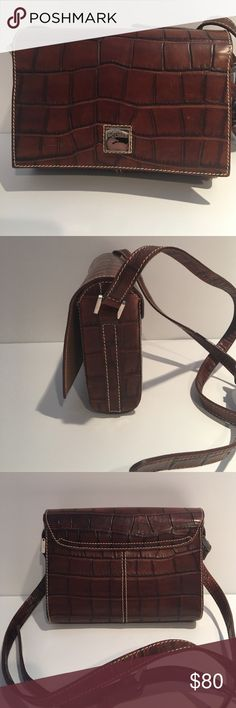 Dooney & Bourke Vintage Crossbody NWOT ,Rare Vintage,Croc Embossed Dooney & Bourke Crossbody .7 X 5 X 2 Magnetic Closure and inside pocket. Original Dust bag included.Smoke Free Environment. Dooney & Bourke Bags Crossbody Bags