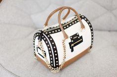 black, white, tan Furla bag