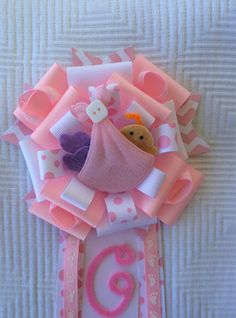 Pink Baby Shower Corsage / Pin The corsage is made with quality ribbons in Pink, White and Poke a Dot. Centerpiece is made of felt and features baby
