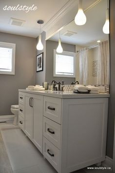 upstairs bathroom lighting idea Wall sconces/pendants on either side are the best way to cross illuminate and prevent shadowing. Place the wall sconces 65-68 inches from the floor (this can vary based on your height, you don't want to look into a bulb).