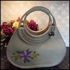 HOST PICKCute Summer Beach/Vacation Handbag Sweet handbag for a summer/ vacation outfit. The front has some nice embroidery Hawaiian Style flowers. Cute beaded accent piece hanging from corner Handel ( faux stones and banana) Inside is very colorful Hawaiian print. See photo for all details. The body is a faux straw (??) the Handel is a circle handle. See photo for Handel details ( material)  Inside is a snap closure. Inside there is a zip pocket. Body width is (center of bag) is 14 inches…