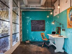 Fabulous industrial style home office with as splash of blue - Decoist