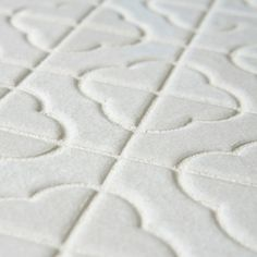 light gray? @Overstock - This Castle mosaic tile by SomerTile has a unique, rustic look that will appeal to those looking for a tile with a striking shape, and inviting color. The slight off-white of this tile has a subtle texture and a light crackle effect.http://www.overstock.com/Home-Garden/SomerTile-Castle-White-Porcelain-Mosaic-Tile-Pack-of-10/6632279/product.html?CID=214117 $152.35