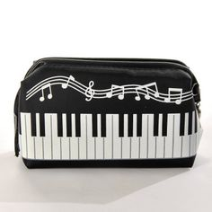 "Music & Note Cosmetic Case Makeup Bag Travel Pouch by ETHAHE. $14.30. Color: Black & White. Length  x Width x Depth: 6.5"" x 2.8"" x 4.5"" (16.5 x 7 x 11.5 cm). ·Cosmetic bag with piano keyboard and music notes pattern on it, very cute   ·Made of high quality fabric, very durable and easy to wash in the machine   ·One main compartment with zipper closure, perfect for holding your cosmetics, pens, applicators, coins, candies, cards, etc   ·Medium size, enough to carry your cosmet..."