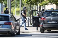 VIERNHEIM, GERMANY - JUNE 23: Heavily-armed police stand outside a movie theatre compelx where an armed man has reportedly opened fire on June 23, 2016 in Viernheim, Germany. According to initial media reports, the man entered the cinema today at approximately 3pm, fired a shot in the air and barricaded himself inside. (Photo by Alexander Scheuber/Getty Images)