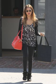 Pin for Later: 96 Ways to Wear Denim, Courtesy of Jessica Alba  Jessica's all-black LA look was the perfect backdrop to make her leopard-print top and bright orange Tory Burch tote really pop.