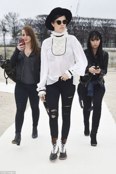 Cara Delevingne wearing Frame Denim Le Color Rip Skinny Jeans in Film Noir and Chanel Pre-Fall 2015