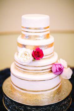 metallic accent wedding cake - photo by Gina Meola Photography http://ruffledblog.com/gem-toned-garden-wedding-in-arizona