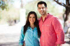 Happy Hispanic couple outdoors stock photo