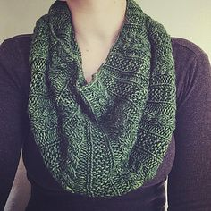A simple cabled cowl with garter stitch ribbing.