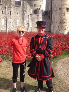 "Hannah Kokoschka after planting poppies at the Tower of London August 2014 with the head beefeater as part of Paul Cummins amazing installation ""Blood Swept Land and Seas of Red."""