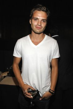 In a white t-shirt drinking a glass of wine. That's why I love him