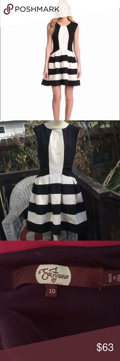 Gorgeous B&W stripedEva Franco anthropologie Gorgeous, EUC black & white striped, sleeveless dress by Anthropologie brand, Eva Franco. Chic, stylish, flattering, ponte, fit-and-flare dress w/unique striped shirt, color blocked, black/white, sleeveless top of dress. Features sturdy fabric with some stretch; slightly ruched waist; hidden side zip closure; crew neckline; sleeveless; pleated, fit/flare skirt; fully lined. Material: 69% rayon; 27% nylon; 4% spandex. Sz 10 Approx. flat…