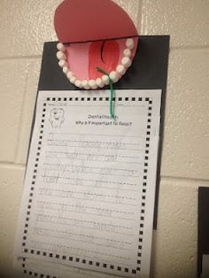Work on dental health w/ primary students w/ this activity. Start w/ a talk about flossing. Show a clip on flossing & get into a discussion on how flossing & brushing helps keep teeth healthy. Make an interactive lesson out of  the project by having kids use pink construction paper to make mouth, draw on a tongue, use mini marshmallows as teeth & then use green yarn to practice flossing teeth before having them write piece why important