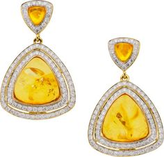 Amber, Diamond, Gold Earrings, Eli Frei  The earrings feature triangle-shaped amber cabochons weighing a total of 4.45 carats, enhanced by full-cut diamonds weighing a total of 1.25 carats, set in 18k gold, completed by posts and friction backs, marked Frei for Eli Frei