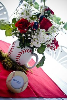 Centerpieces In Large Baseball Mugs Sat On Moss And A Red Napkin Sox
