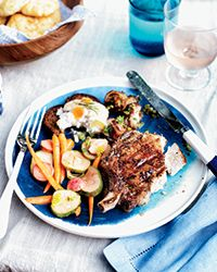 Grilled Double-Cut Pork Chops - These pork chops are cut doubly thick so it's easy to give them a good char on the grill while keeping them super-juicy. They're also perfectly seasoned all the way through after a two-day soak in a brine packed with aromatics like juniper and onion. Recipe on Food & Wine