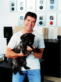 Celebs and their pets! Simon Cowell and Buster! Pet Dogs, Dogs And Puppies, Dog Cat, Pet Pet, Doggies, Famous Dogs, Famous People, Famous Names, Love Pet