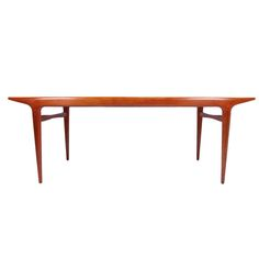 Dining Table by Carlo di Carli. Sculptural table with mahogany top with high polish finish, light mahogany stained base. Early production from Italy, ca.1950