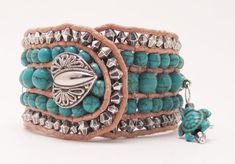 This bracelet is a full 1 1/2'' wide with three rows of turquoise Howlite Turkish gemstones and two outer rows of acrylic silver bicone beads. The bracelet is made with natural leather and finished with a metal heart button. There are four lovely turquoise Howlite turtle charms to finish this wonderful bracelet. This cuff looks great with Westernwear!  Fits a 7'' wrist comfortably  $55.00