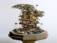 The Japanese art of raising bonsai trees is a beautiful way to infuse greenery into indoor spaces. But artist Takanori Aiba takes the art to a new level with his incredibly intricate series of bonsai castles. The Japanese artist carves miniature masterpieces that weave in and out of the miniature trees, creating cohesive architectural marvels that burst forth with life!