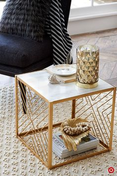 Bring that golden touch to your living room with this Nate Berkus crisscross table. It's a little funky, and a lot of classy, and the perfect surface for your finer things.:
