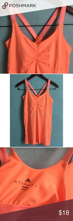 Neon Adidas Climate Top ▫️Adidas Climate Top ▫️Criss Cross Back  ▫️True to Size (see measurements) ▫️Color: Neon Orange  ▫️Shelf Bra: Yes (not padded) ▫️Adidas Top in Good Preowned Condition adidas Tops Tank Tops