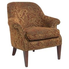 Slope-armed chair with paisley upholstery and nailhead trim.  Product: Arm chairConstruction Material: Wood and ...