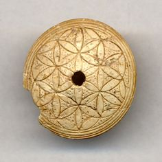 Ivory spindle whorl. Cyprus, 1340-1050BC. Late Cypriot IIC or Late Cypriot III. British Museum