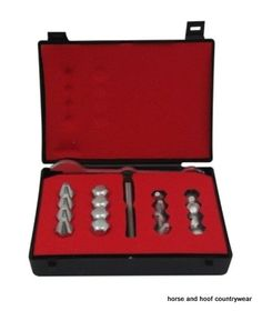 Liveryman 16 Stud Presentation Box A black presentation box containing a selection of sixteen assorted studs standard pointed road and dome and tap and spanner.