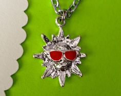 $17.00.  GOOD MORNING SUNSHINE necklace.  Sun with sunglasses, so cute!  :)