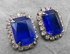 Lustrous rhinestones pick up the light and sparkle like diamonds in this gorgeous pair of blue earrings.