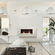 ST900 INDOOR GAS FIREPLACE  Beautiful installation of the  Artemide NUR suspension.